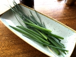 The green tops of spring onions and chives